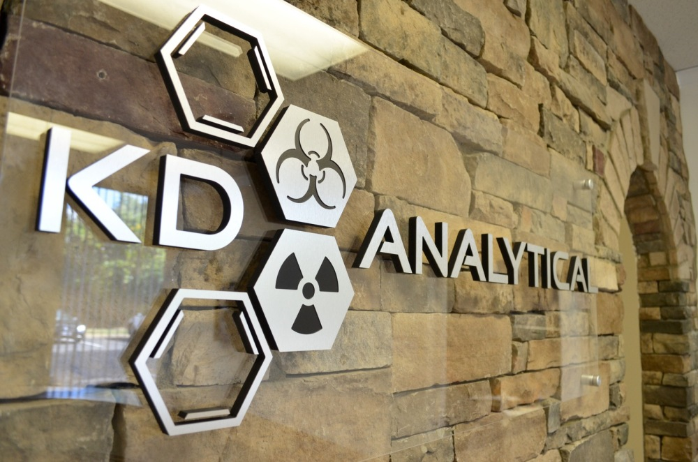 New KD Analytical logo sign in the reception area of the National Capital Region office.