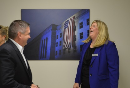 Vice President of Sales and Marketing, Pat Dempsey and Director of Sales, Erica Wolfkill convene before a dramatic photo of the Pentagon.